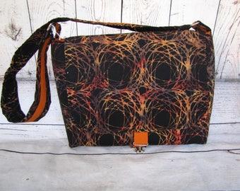 Black and burnt swirl messenger bag.
