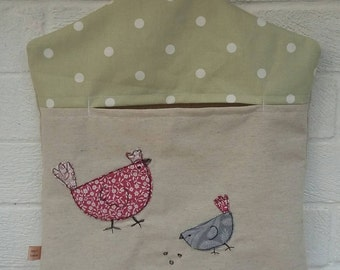 Peg bag with chickens appliqué free motion embroidery. Hen and chick laundry bag with green polka dot