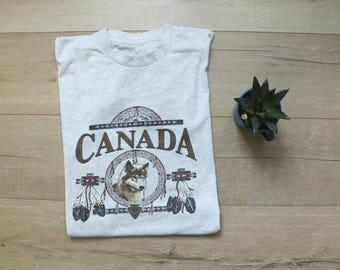 Vintage 90s Canada heather grey t-shirt with wolf, medium