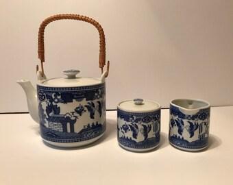 Pretty blue willow pattern tea set - tea pot, sugar and creamer