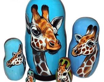 Giraffe on Five Russian Nesting Dolls. Wild Life.