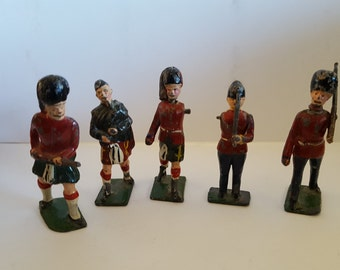 Vintage 1950's toy lead soldiers, Redcoats, Black Watch, Grenadier Guards, Bagpiper, rough condition