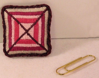 Dream catcher needlepoint pillow burgundy cranberry raspberry pink and silver. Mauve satin back, braid trim. 1 to 12 scale.  Handmade USA.