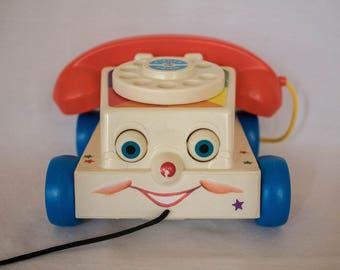 Two 1960's Toys- Chatter Phone & Train