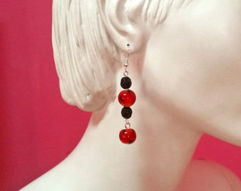 Black and red crystal dangle earrings. Silver fashion accesories for her. Elegant gift for girlfriend. Night time.