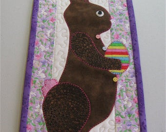 This handmade quilted and appliquéd wall hanging of a chocolate bunny is just the thing for the Easter season