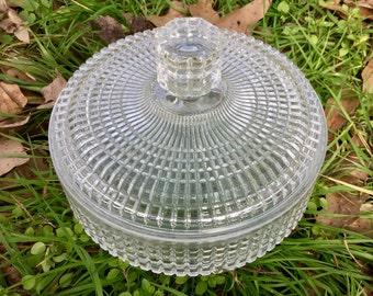 Vintage pressed glass covered bowl. Unusual pattern
