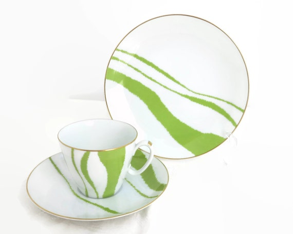 Mid 20th century Noritake cup, saucer, plate, white background with mod lime green lines in seemingly random pattern, gold trim, circa 1960s