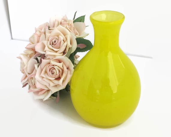 Mid 20th century yellow glass vase with narrow neck and bulbous base, bright yellow transparent glass layered over opaque white glass, 1960s