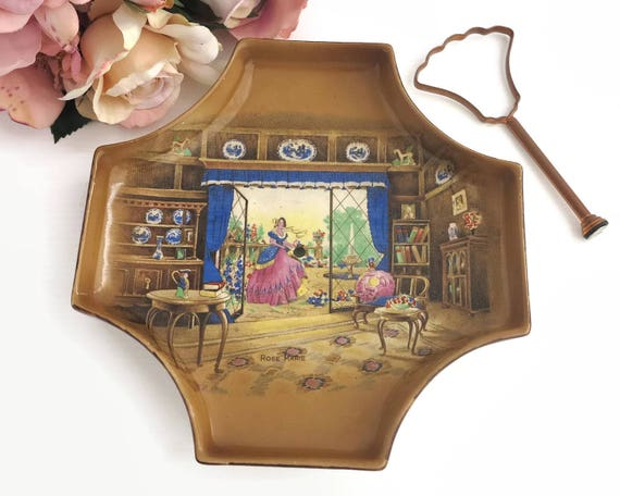 Antique cake plate / tray with copper handle, scene of lady in Victorian dress in well furnished room, Lancaster and Sons, England, 1920s