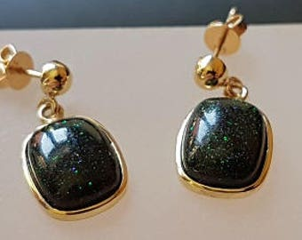 A lovely pair of gold opal earrings