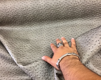 Gray ostrich faux leather vinyl embossed fabric. Sold by the yard.