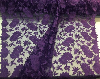 Purple daisy flower design embroider on a mesh lace -yard