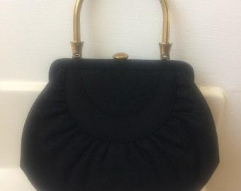 Black wool with brass handbag