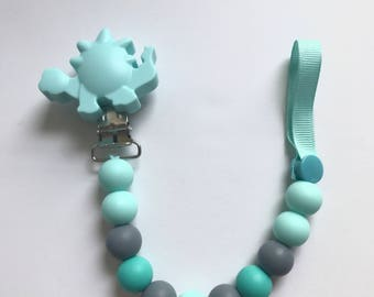 Chompy Paci Clip With Dino-Turquoise