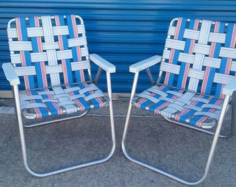Vintage pair of retro aluminum webbed lawn chairs blue white pink yellow