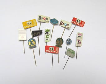 Vintage advertising lapel pins: job lot of 14 chocolate badges. Collectible or for use in crafts, altered art, collage, mixed media. OT579