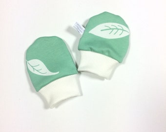 Mint organic baby scratch mitts. Infant mittens with cuffs. Shower gift. Green knit fabric with leaves. Gender neutral no scratch mitts