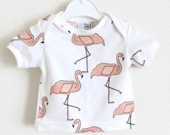 Organic baby lap neck shirt with pink flamingos. Toddler t-shirt. Kid's top. White shirt. Cotton knit fabric.