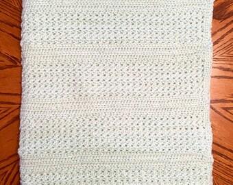 Hand-crocheted, light-teal heirloom baby blanket
