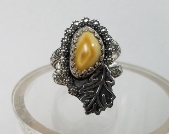 This Elk Tooth Ring is hand crafted out of Sterling Silver and does (NOT) include tooth