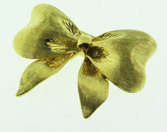 Vintage 1960's gold bow brooch / pin. 18K gold.