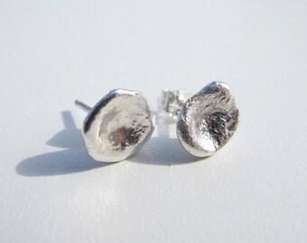 Pair of Watercast stud earrings