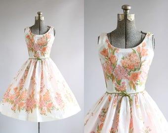Vintage 1950s Dress / 50s Cotton Dress / Youth Fair Juniors Pink and Apricot Floral Border Print Dress XXS