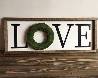 Love sign with moss wreath
