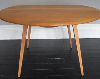 Ercol Oval Drop Leaf Table.