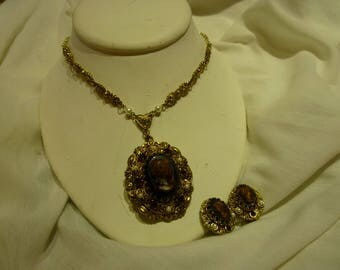 F51 Made in West Germany Marked Gold Toned Large Chocolate Cameo Pendant on Matching Chain w/Matching Earrings.