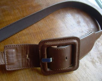 GAUDI vintage tan LEATHER  BELT has 3 inch sq. leather buckle. Hardly worn. 32-36 in.