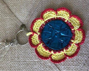Crochet Flower Bag Charm Car Charm Keychain Made from Nespresso Coffee Pod - Red and Yellow with blue center