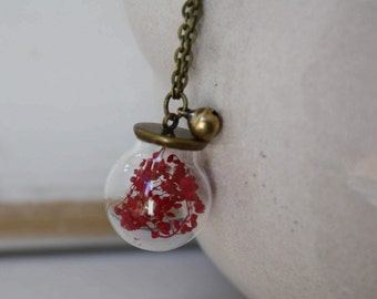 Handmade necklace with flowers and dried red bell