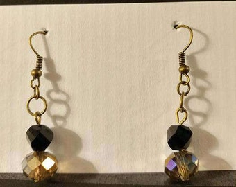 Black and brown circle beads with bronze fishhook
