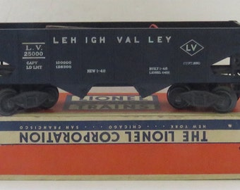 2 Vintage Lionel Electric Trains 2671 W Coal & 6456 Lumber in Original Boxes.
