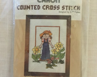 1981 Caron Blue Jean Girl, 5 X 7 Counted Cross Stitch Kit, Blue Jean Girl, with Bib Overalls and Flowers. Cross Stitch Kit, 6247, J.T. Ogden