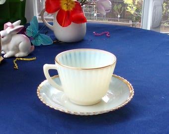 MacBeth Evans 1940's Cremax gold rimmed tea/ coffee cup & saucer set. Petalware ivorene, Ivory,beige or cream glass Transparent at edges .