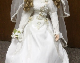 Vintage porcelain doll/bride in wedding dress by unknown manufacturer, circa 1990's