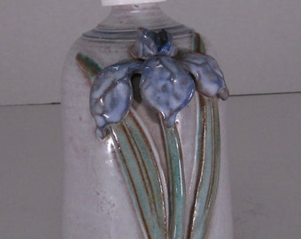 Vintage pottery soap dispenser Priscilla iris on front with leaves signed on bottom no chips great condition