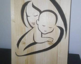 painting wood tunnel with mother and baby