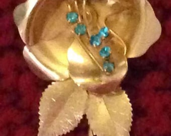 Gold color brooch w/ topaz stones