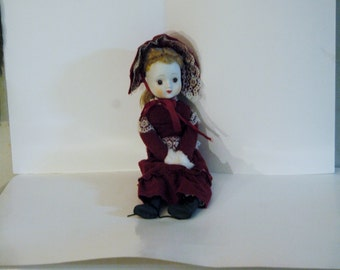 Vintage Porcelain Doll With Red Dress ( by Albert E. Price)