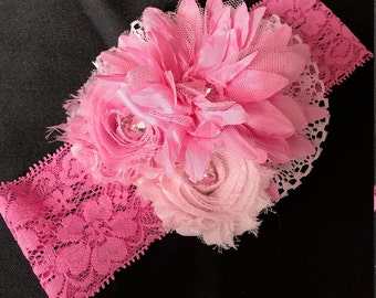 Pink flower infant/baby/premie elastic lace headband. Two delicate pink flowers along the larger one.  Pink Lace elastic