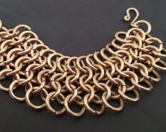 Woven bracelet with copper rings