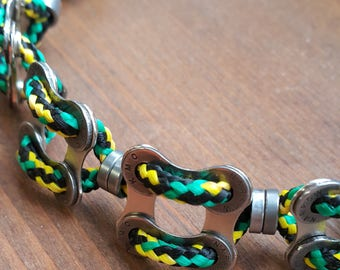 "Upcycled bicycle chain men's bracelet with green-yellow-black cord ""Quad"""