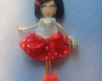 Felt brooch doll
