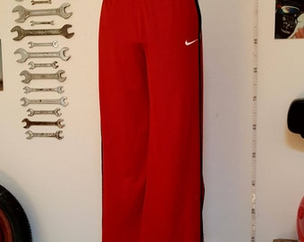 Red tracksuit bottoms by #Nike