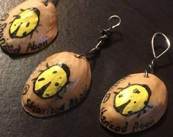 Yellow Lady Bug Pistachio Charm