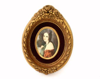 Cameo Creations Style Portrait of Dark Haired Female in Ornate Oval Gold Floral Frame with Red Velvet Background